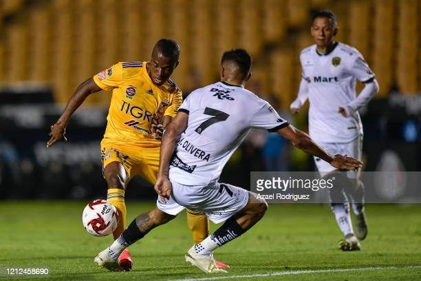 Enner Valencia of Tigres fights for the ball with Maximiliano Olivera of Juárez during the 10th round match between Tigres UANL and FC Juarez as part...
