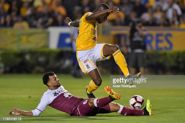Enner Valencia of Tigres fights for the ball with Michael Barrantes of Saprissa during a round of sixteen second leg match between Tigres and...