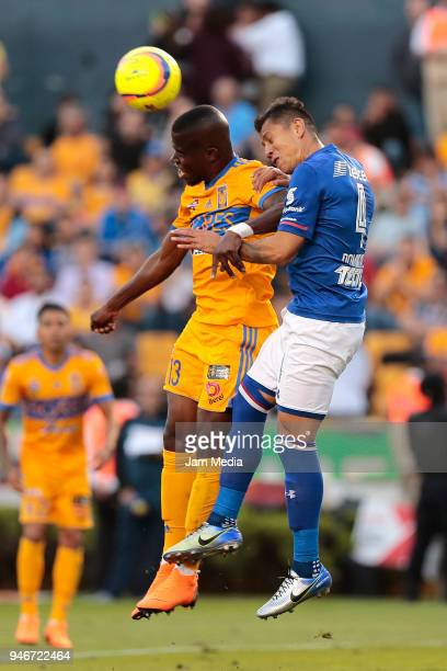 Enner Valencia of Tigres heads the ball over the mark of Julio Dominguez of Cruz Azul during the 15th round match between Tigres UANL and Cruz Azul...