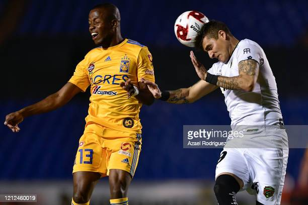 Enner Valencia of Tigres heads the ball with Bruno Romo of Juárez during the 10th round match between Tigres UANL and FC Juarez as part of the Torneo...
