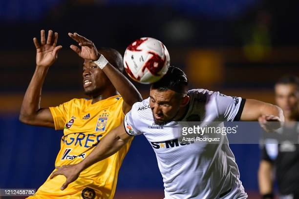 Enner Valencia of Tigres heads the ball with José Esquivel of Juárez during the 10th round match between Tigres UANL and FC Juarez as part of the...