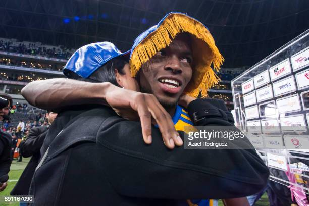 Enner Valencia of Tigres hughs his wife after winning the second leg of the Torneo Apertura 2017 Liga MX final between Monterrey and Tigres UANL at...