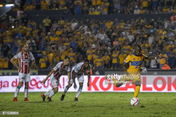 Enner Valencia of Tigres takes a penalty kick to score his team's first goal during the 16th round match between Tigres UANL and Necaxa as part of...