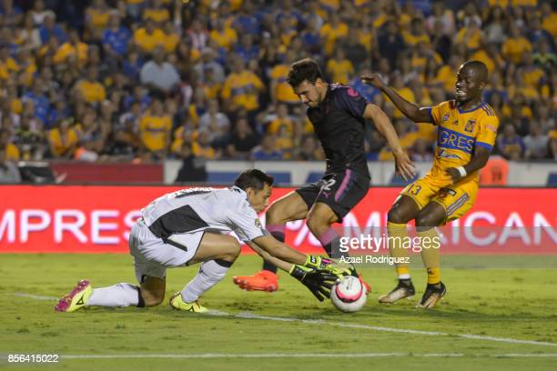 Enner Valencia of Tigres tries to score over Rodolfo Cota goalkeeper of Chivas during the 12th round match between Tigres UANL and Chivas as part of...