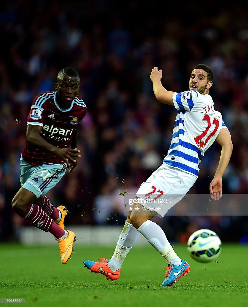 Enner Valencia of West Ham battles for the ball with Adel Taarabt of QPR during the Barclays Premier League match between West Ham United and Queens Park Rangers at Boleyn Ground on October 5, 2014 in London, England.