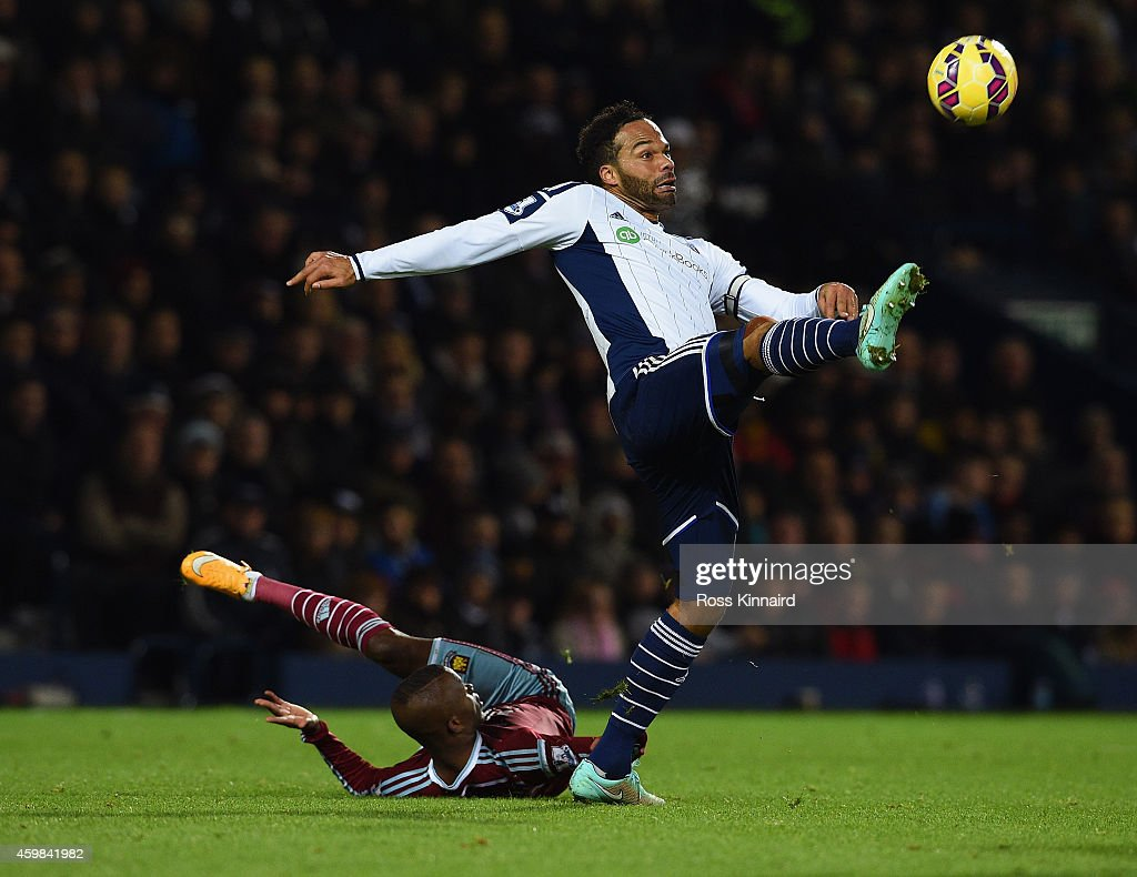 Enner Valencia of West Ham is beaten to the ball by Joleon Lescott of West Brom during the Barclays Premier League match between West Bromwich Albion and West Ham United at The Hawthorns on December 2, 2014 in West Bromwich, England.