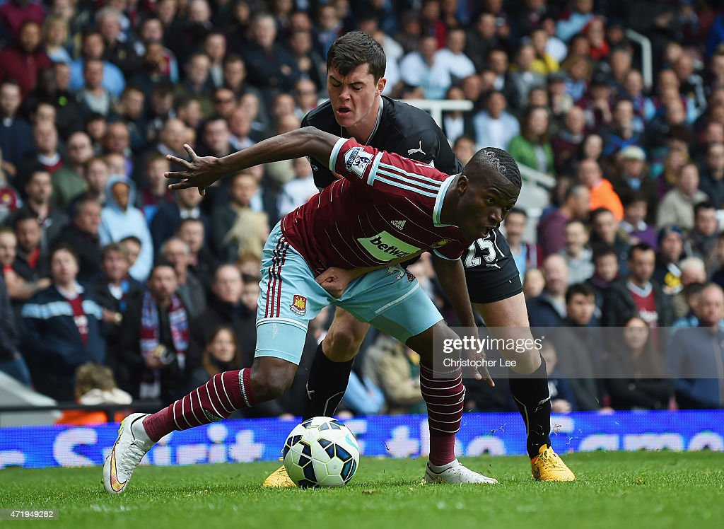 Enner Valencia of West Ham United and Michael Keane of Burnley compete for the ball during the Barclays Premier League match between West Ham United and Burnley at the Boleyn Ground on May 2, 2015 in London, England.