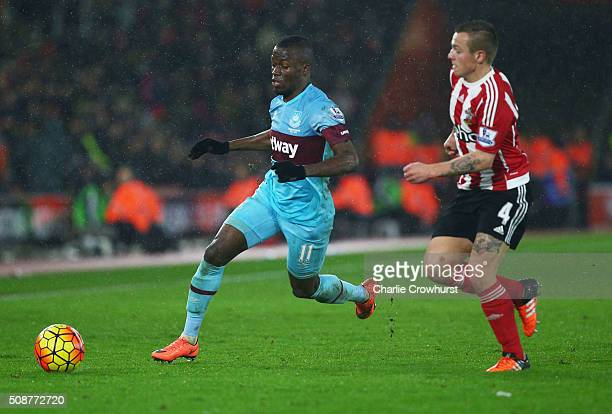 Enner Valencia of West Ham United is chased by Jordy Clasie of Southampton during the Barclays Premier League match between Southampton and West Ham...