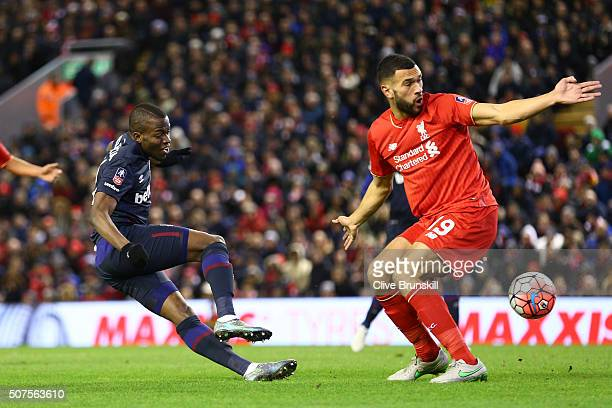 Enner Valencia of West Ham United shoots past Steven Caulker of Liverpool during the Emirates FA Cup Fourth Round match between Liverpool and West...