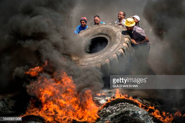 TOPSHOT Ennerdale community members burn tyres to protest the lack of police and government action against drug abuse for better housing and basic...