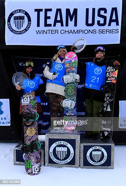Enni Rukajarvi of Finland in second place Jamie Anderson in first place and Klaudia Medlova from Slovakia in third celebrate on the podium in the...