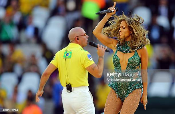 ennifer Lopez and rapper Pitbull perform during the Opening Ceremony of the 2014 FIFA World Cup Brazil prior to the Group A match between Brazil and...