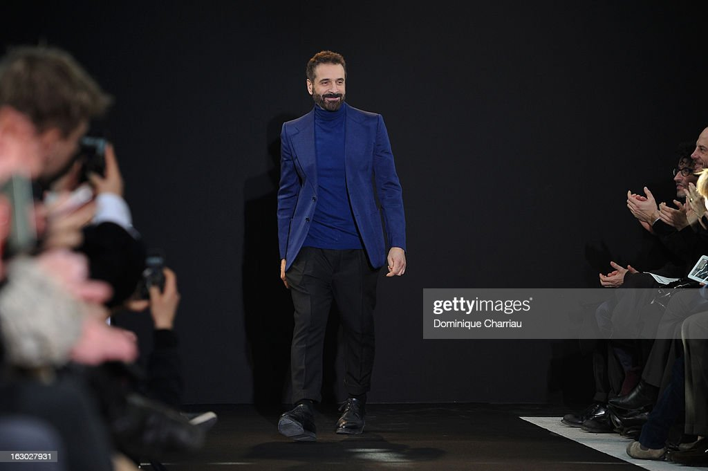 Ennio Capasa acknowledges the crowd during the Costume National Fall/Winter 2013 Ready-to-Wear show as part of Paris Fashion Week on March 3, 2013 in Paris, France.