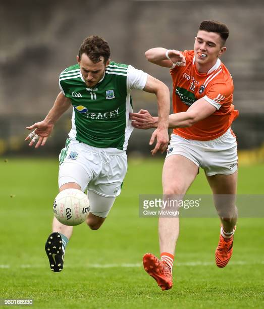 Enniskillen Ireland 19 May 2018 Declan McCusker of Fermanagh in action against Ben Crealey of Armagh during the Ulster GAA Football Senior...