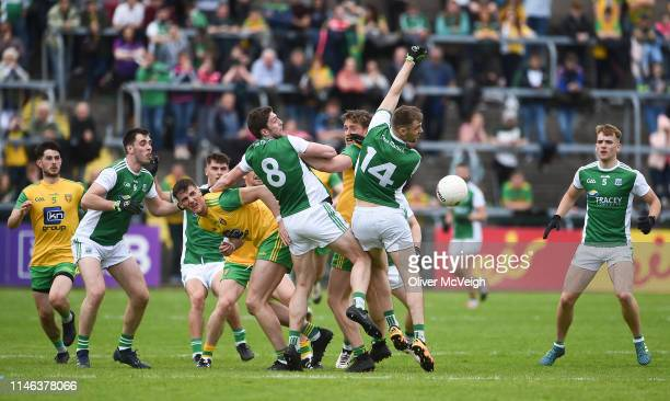 Enniskillen Ireland 26 May 2019 Eoin Donnelly and Conal Jones of Fermanagh in action against Hugh McFadden of Donegal during the Ulster GAA Football...