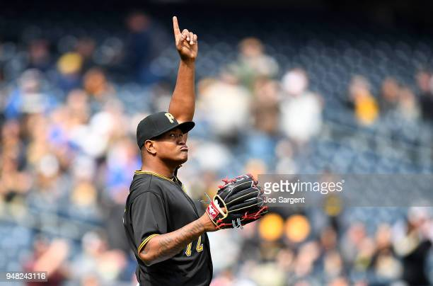 Enny Romero of the Pittsburgh Pirates celebrates after a 102 win over the Colorado Rockies at PNC Park on April 18 2018 in Pittsburgh Pennsylvania