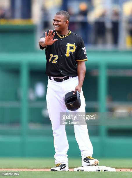 Enny Romero of the Pittsburgh Pirates celebrates his first Major League hit during the eighth inning against the Colorado Rockies at PNC Park on...