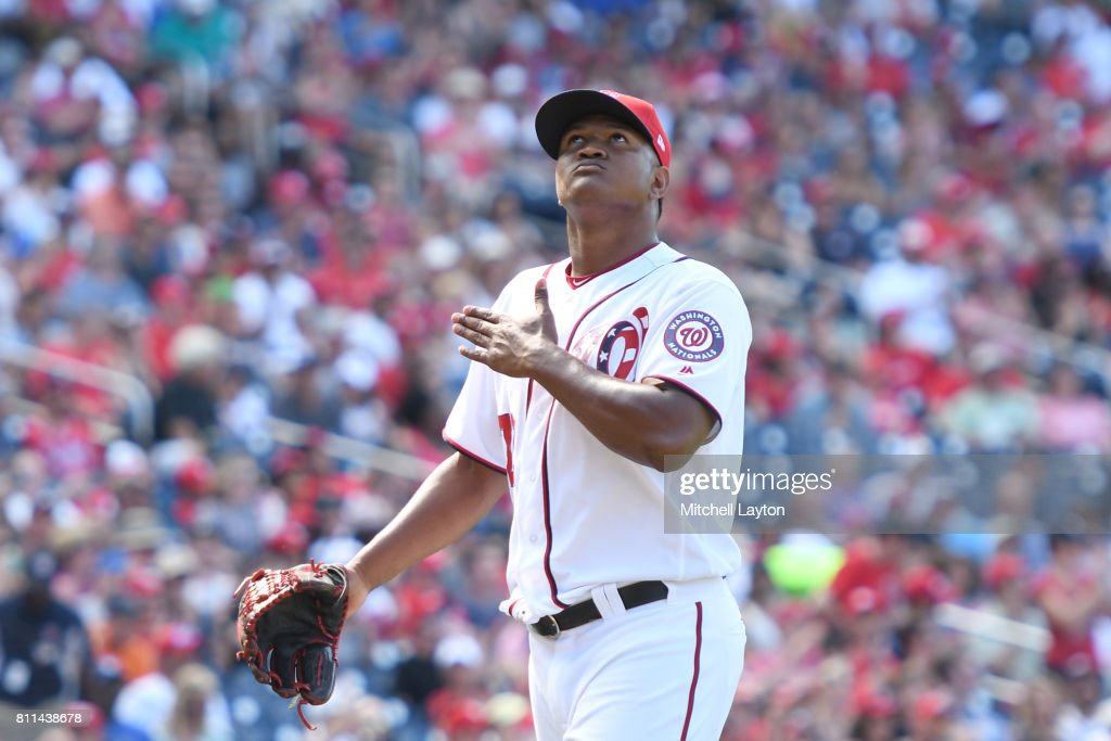 Enny Romero #72 of the Washington Nationals celebrates an out in the eighthinning during a baseball game against the Atlanta Braves at Nationals Park on July 9, 2017 in Washington, DC. The Nationals won 10-5.