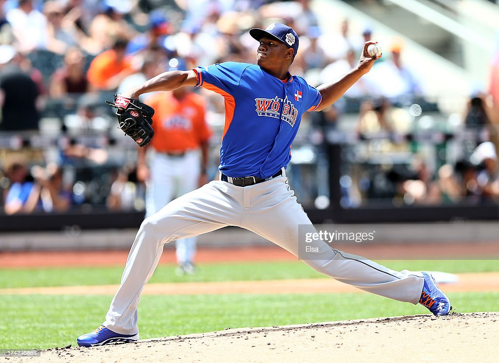 Enny Romero #27 of the World Team delivers a pitch against the United States on July 14, 2013 at Citi Field in the Flushing neighborhood of the Queens borough of New York City. The United States defeated the World Team 4-2.