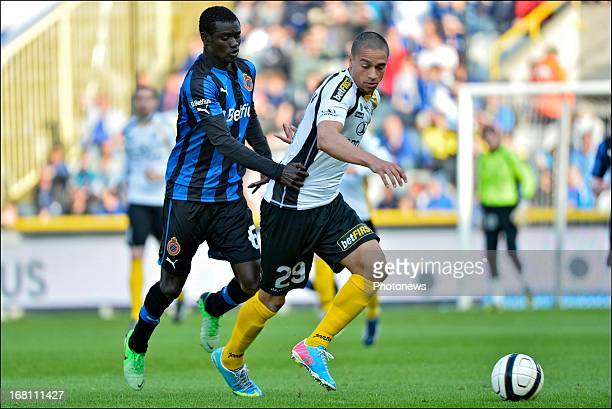 Enock Adu of Club Brugge KV and Nill De Pauw of Sporting Lokeren OVL compete for the ball during the Jupiler Pro League playoff 1 match between Club...