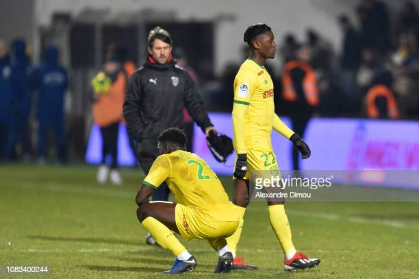 Enock Kwateng and Anthony Limbombe of Nantes look dejected after defeat during the Ligue 1 match between Nimes and Nantes at Stade des Costieres on...