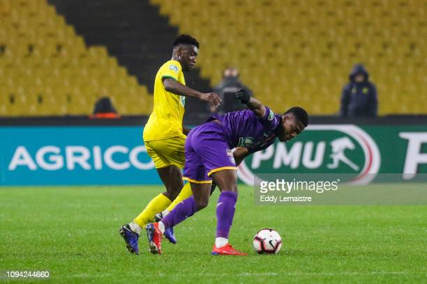 Enock Kwateng of Nantes and Aaron Leya Iseka of Toulouse during the French Cup match between Nantes and Toulouse at Stade de la Beaujoire on February...