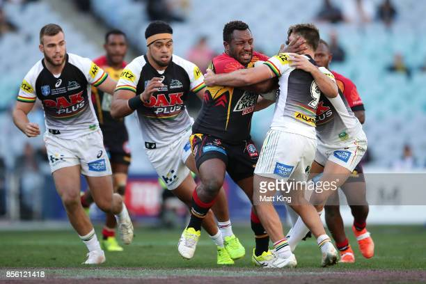 Enock Maki of the Hunters is tackled during the 2017 State Championship Final between the Penrith Panthers and Papua New Guinea Hunters at ANZ...