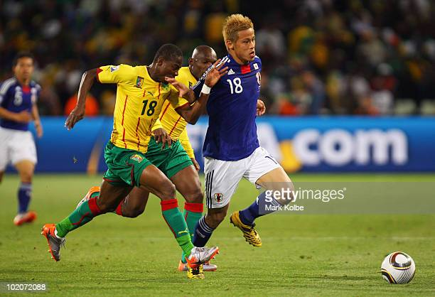 Enoh Eyong of Cameroon and Keisuke Honda of Japan battle for the ball the 2010 FIFA World Cup South Africa Group E match between Japan and Cameroon...