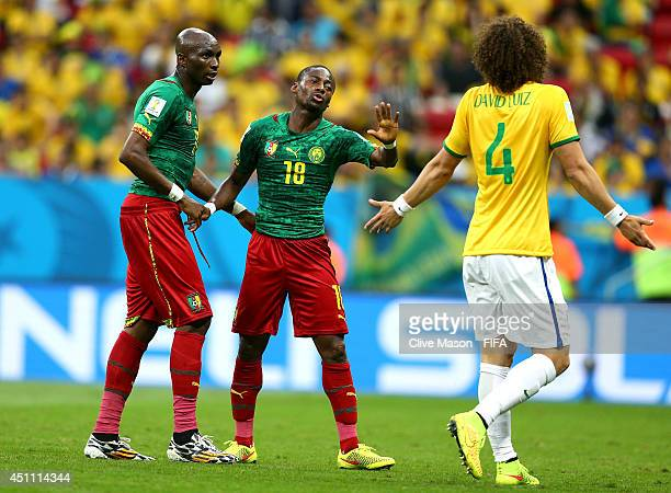 Enoh Eyong of Cameroon speaks to David Luiz of Brazil during the 2014 FIFA World Cup Brazil Group A match between Cameroon and Brazil at Estadio...