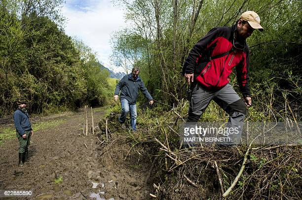 """Enologists walk along the vineyard at Villasenor winery, where the """"Puelo Patagonia"""" wine is produced, in Puelo, Los Lagos Region, Chile on October..."""