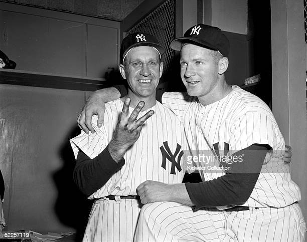 Enos Slaughter and Whitey Ford of the New York Yankees celebrate in the clubhouse after winning World Series Game 3 on October 6 1956 at Yankee...