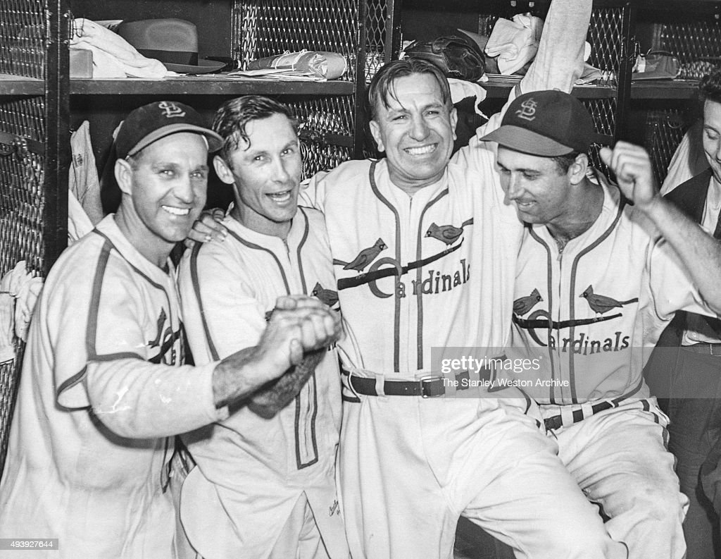 Enos Slaughter, Harry Brecheen, manager Eddie Dyer, Harry Walker of the St. Louis Cardinals celebrate after their Game 7 win over the Boston Red Sox for the 1946 World Series at Sportsman's Park III on October 15, 1946 in St. Louis, Missouri.