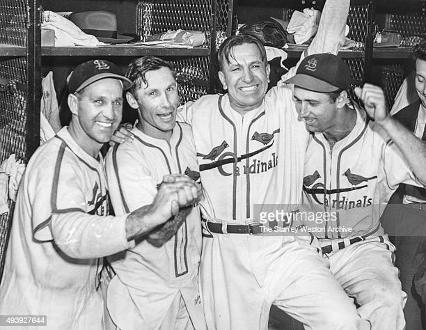 Enos Slaughter Harry Brecheen manager Eddie Dyer Harry Walker of the St Louis Cardinals celebrate after their Game 7 win over the Boston Red Sox for...