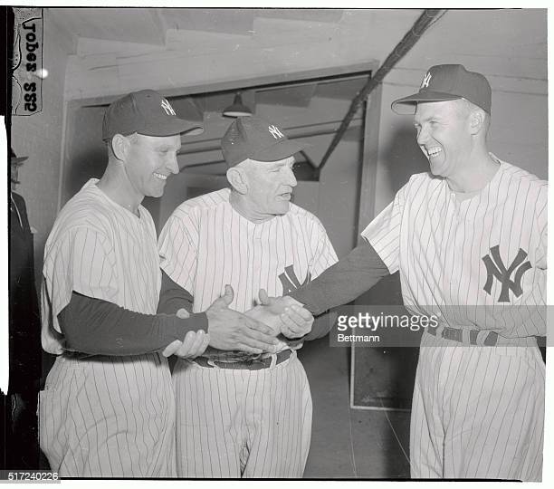 Enos Slaughter New Yankee player who played formerly with the Cards prepares to shake hands with Bobby 'Doc' Brown Yankee man who has returned to the...