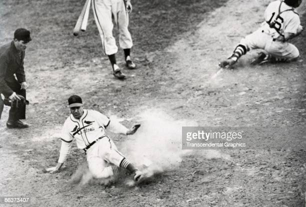 ST LOUIS OCTOBER 151946 Enos Slaughter of the Cardinals slides home with the winning run in game seven of the World Series in Sportsmans Park in St...