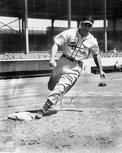 Enos Slaughter of the St Louis Cardinals poses for an action portrait Enos Slaughter played for the Cardinals from 19381953