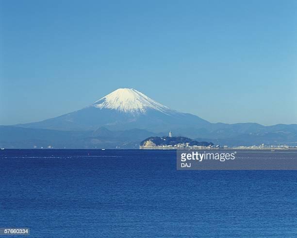 enoshima island and mt. fuji - zushi kanagawa stock photos and pictures