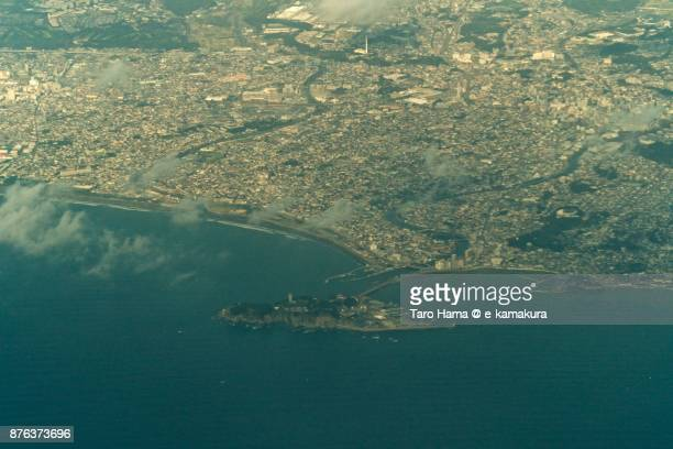 Enoshima Island, Fujisawa and Kamakura cities in Kanagawa prefecture in Japan daytime aerial view from airplane