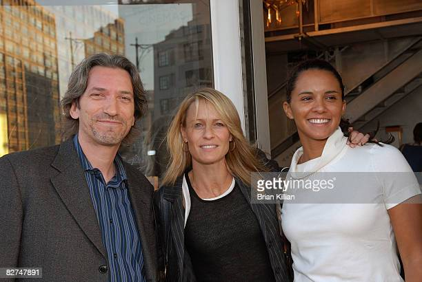 """Enough co-chair John Prendergast, actress Robin Wright Penn and Congo analyst Rebecca Feeley attend a screening of """"Invisibles"""" at the Tribeca..."""