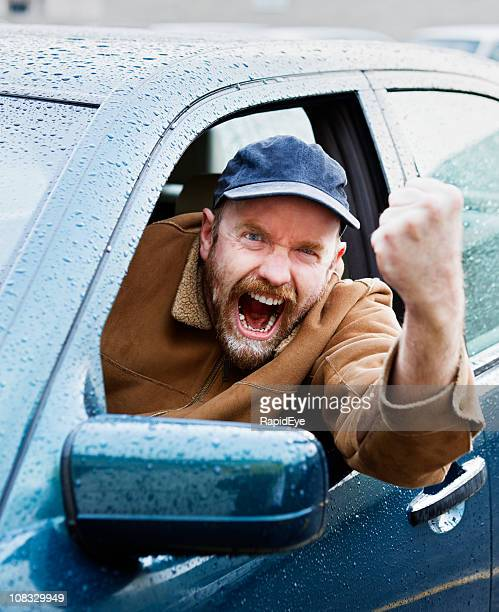 Enraged driver shakes fist out of car window