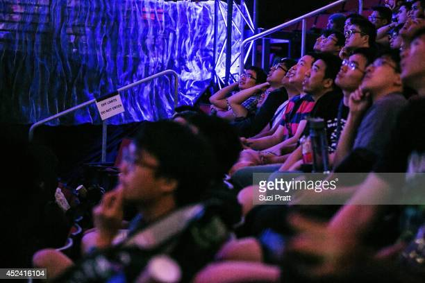 Enraptured fans from China watch a match unfold at The International DOTA 2 Champsionships at Key Arena on July 19 2014 in Seattle Washington