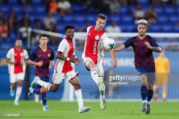 Enric Llansana of Ajax U19 competes for the ball with Alvaro Sanz of FC Barcelona during their friendly match between FC Barcelona U19 and Ajax U19...