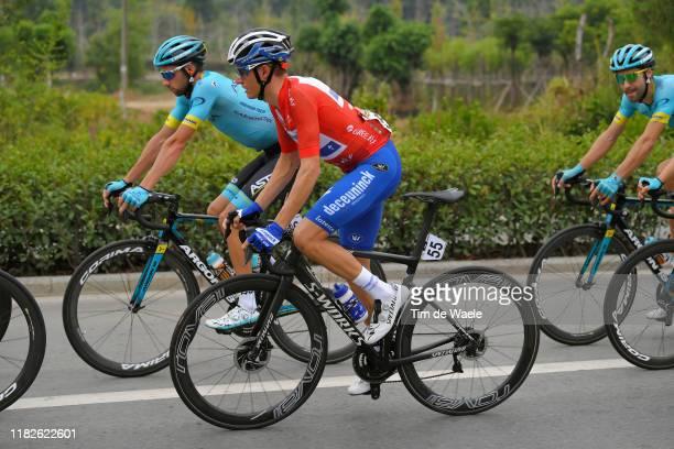 Enric Mas Nicolau of Spain and Team Deceuninck QuickStep Red Leader Jersey / Davide Villella of Italy and Astana Pro Team / Laurens De Vreese of...