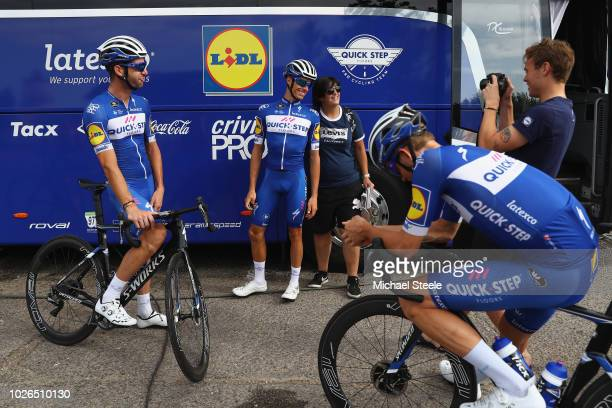 Enric Mas Nicolau of Spain and team QuickStep poses for a photograph as Fabio Sabatini of Italy and Kasper Asgreen of Denmark look on ahead of a...
