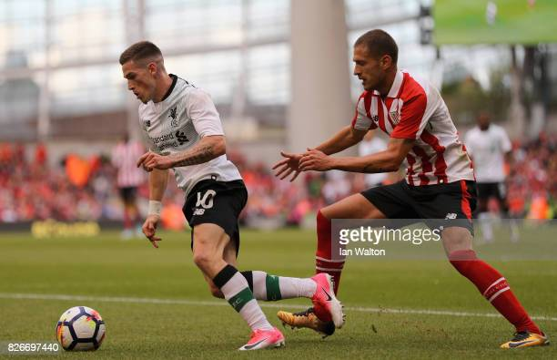 Enric Saborit of Athletic Club attempts to tackle Ryan Kent of Liverpool during the Pre Season Friendly match between Liverpool and Athletic Club at...