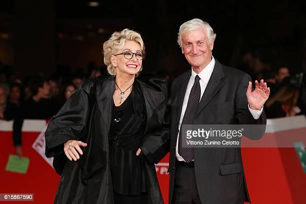 Enrica Bonaccorti and Piero Badaloni walk a red carpet for 'Florence Foster Jenkins' during the 11th Rome Film Festival at Auditorium Parco Della...