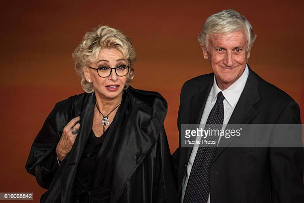 Enrica Bonaccorti and Piero Badaloni walk the red carpet honoring Gregory Peck during the 11th Rome Film Festival in Rome Italy