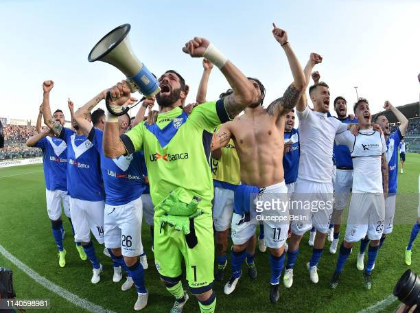 Enrico Alfonso of Brescia Calcio celebrates with his teammates after winning the Serie B championship after the Serie B match between Brescia Calcio...