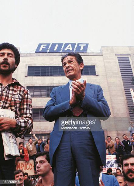 Enrico Berlinguer general secretary of the Italian Communist Party is participing in a meeting with workers outside the headquarters of Fiat...