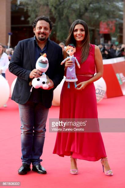 Enrico Brignano and Serena Rossi walk a red carpet for 'Frozen. Olaf's Frozen Adventure' during the 12th Rome Film Fest at Auditorium Parco Della...